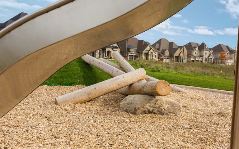 fallen log wood boulders playground natural