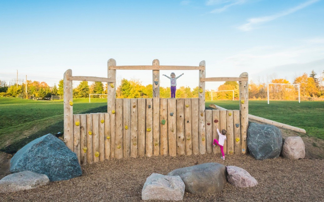 natural playground embankment hill boulders climbing wall