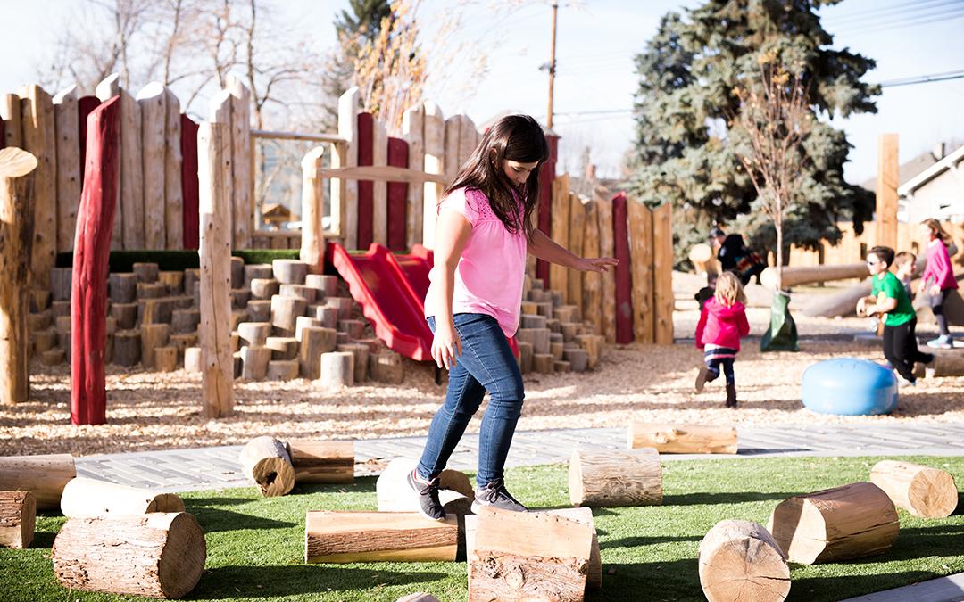 Mills Park Calgary natural play log challenge