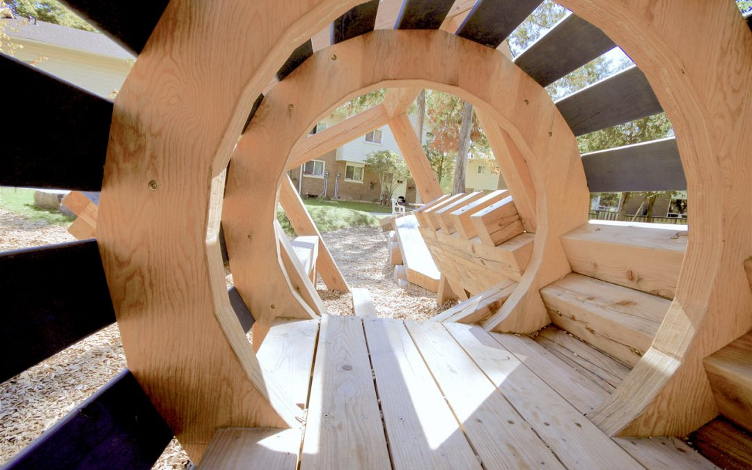 train themed wood sculpture tunnel