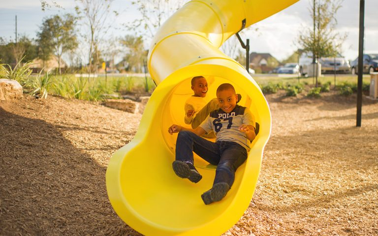 Giant slide natural playground tower