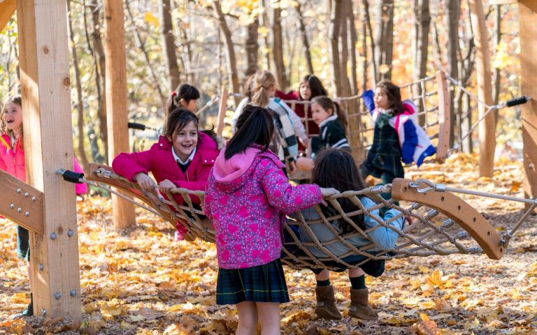 hammocks girls playing natural playground forest