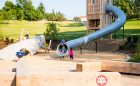 confederation calgary playground natural custom slide bunch sculpture