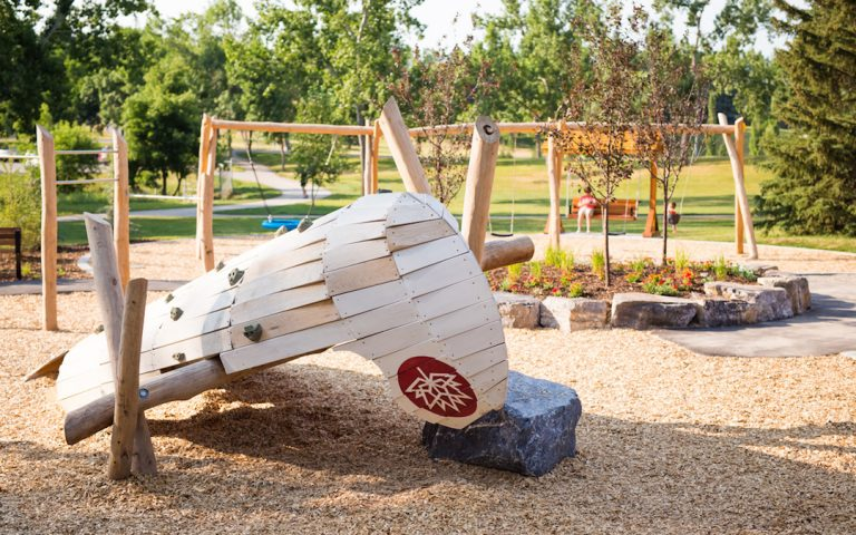 natural playground wood calgary park canoe sculpture