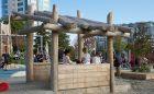 creekside park sand play log hut natural playground