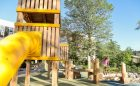 natural playground tower tube slide