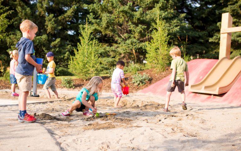 sand play slide children playground natural calgary