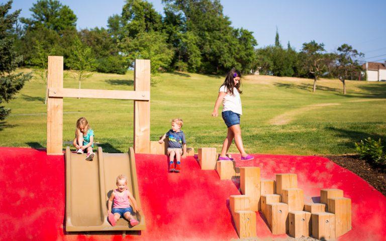 slide poured rubber playground calgary timber climb