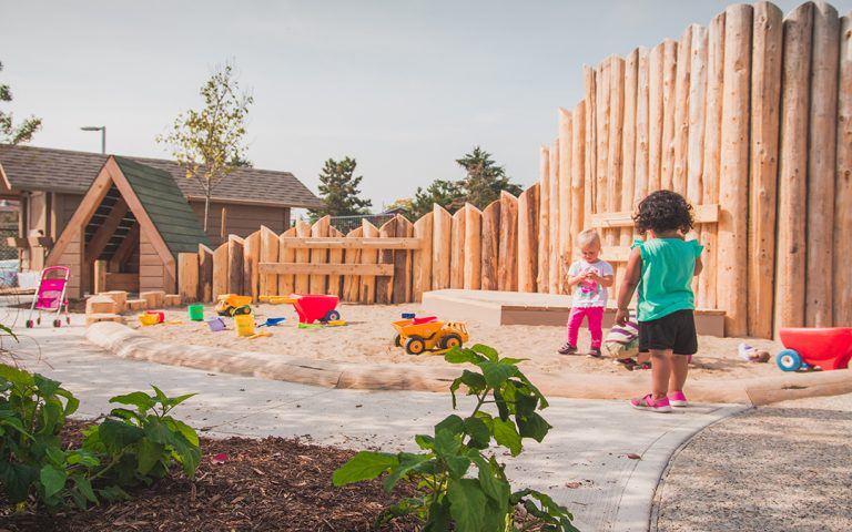 st bernadette log palisade wall playground