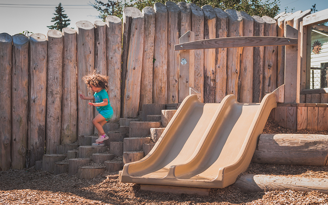 child care centre natural playground slide