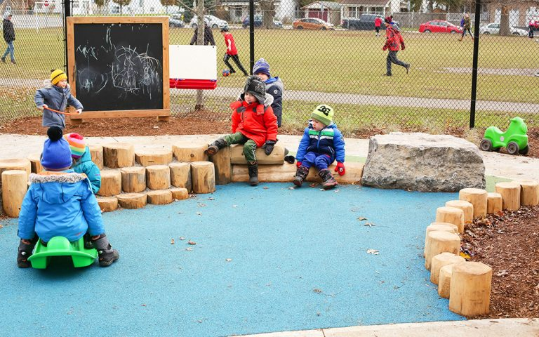 YWCA Hamilton log boulders childrens play