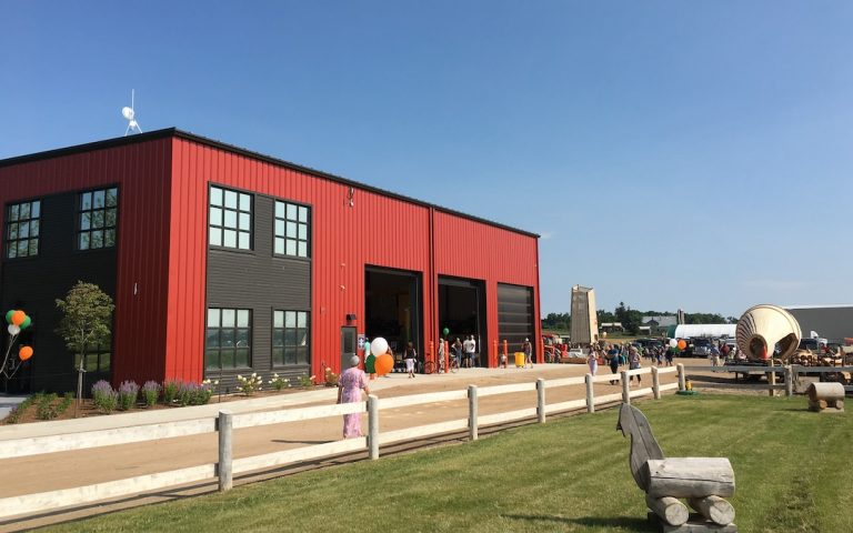 red and charcoal barn-style office building new design studio