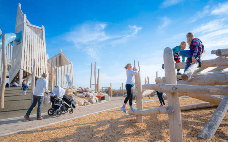 Wanuskewin Saskatoon natural playground abstract wood towers rubber log climber