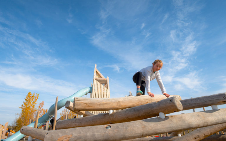 Wanuskewin Saskatoon playground of natural wood log climbing tower