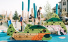 Custom natural wood playground fish climbing walls accessible surfacing