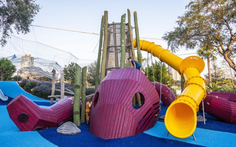 Kraken octopus sculpture destination playground Florid robinia log tower nets