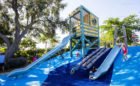 lifeguard themed marine tower slide notched logs climbing Florida destination playground