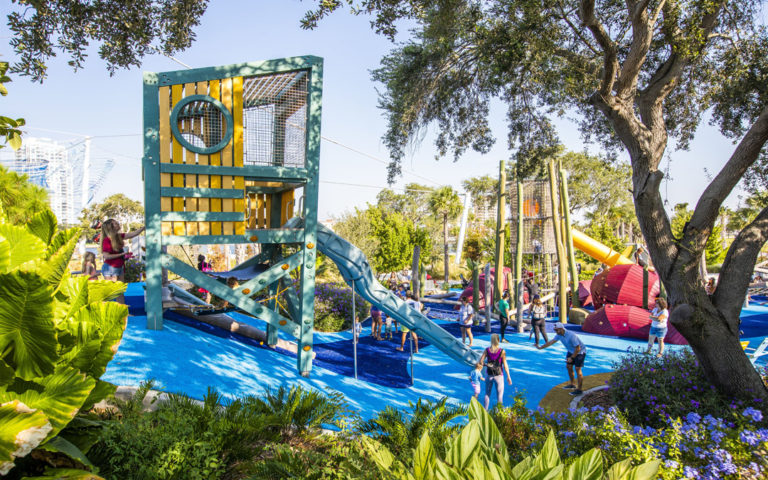 marine themed playground Florida lifeguard tower slides logs natural wood