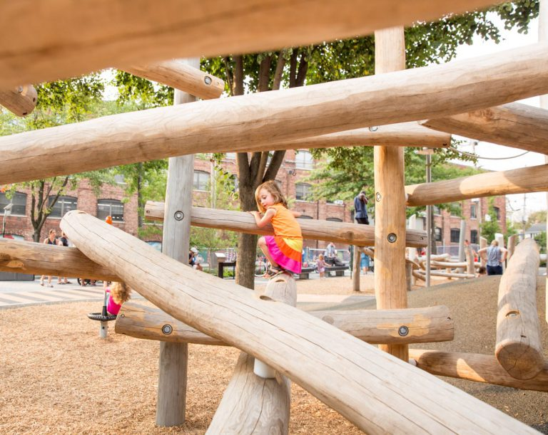 Child playing on wooden playground