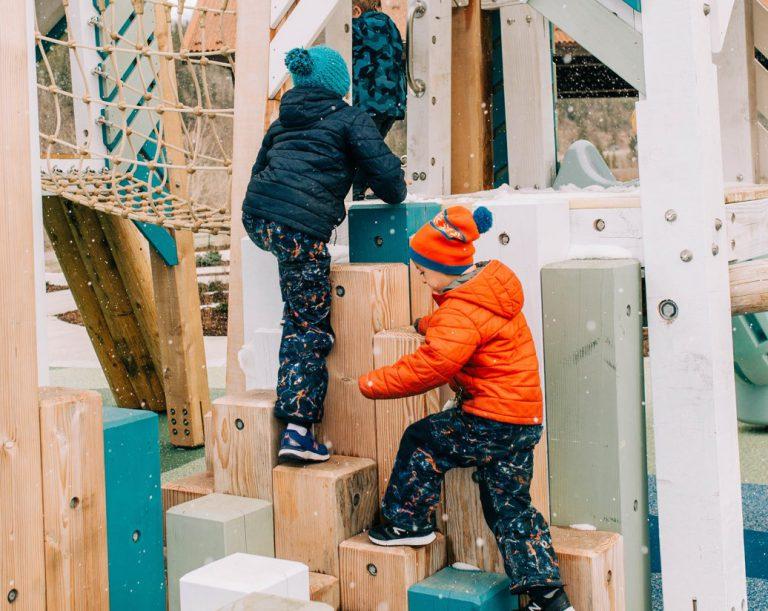 Children climbing on an Earthscape playground