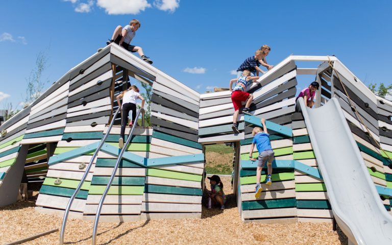 Children playing on an Earthscape playground
