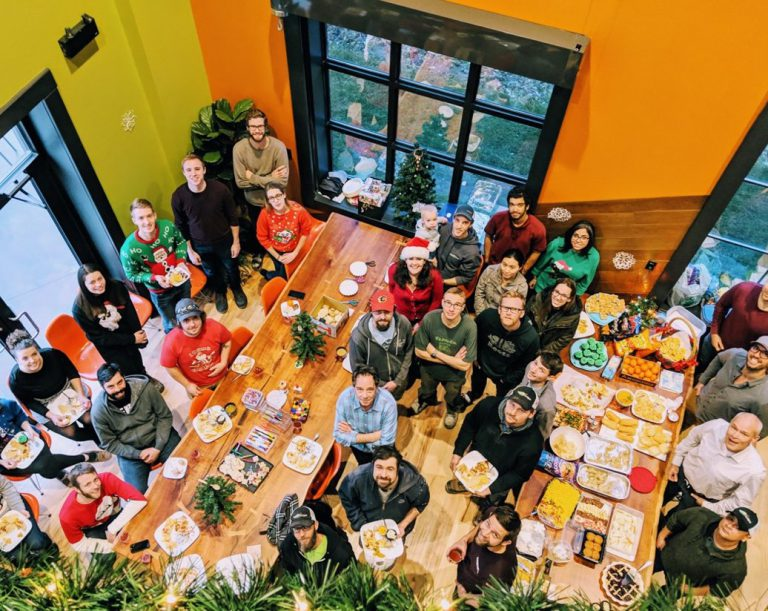 Group photo of the Earthscape team having a holiday meal together