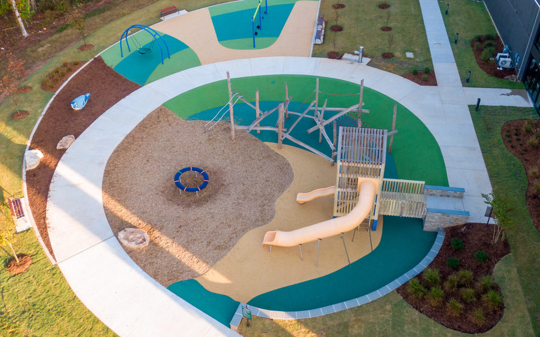 Joyner Park community playground tower slides log jam climber nets ropes swings