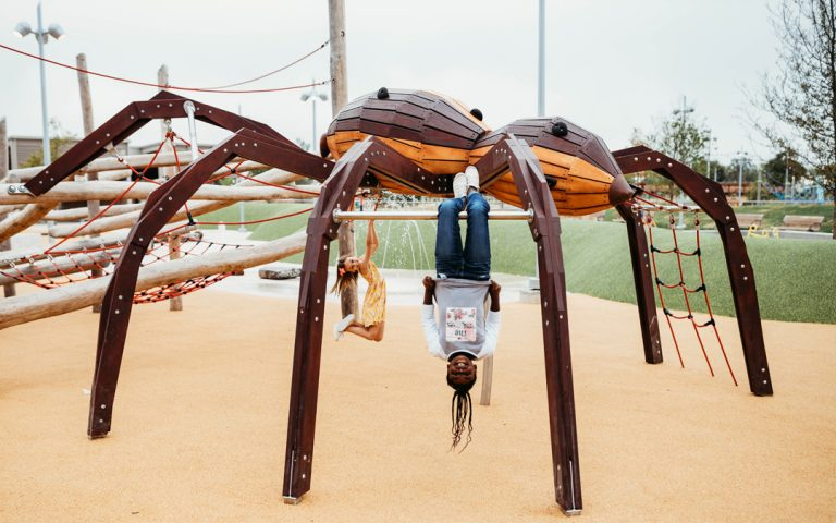 wolf spider sculpture with kids at scissortail park in oklahoma city