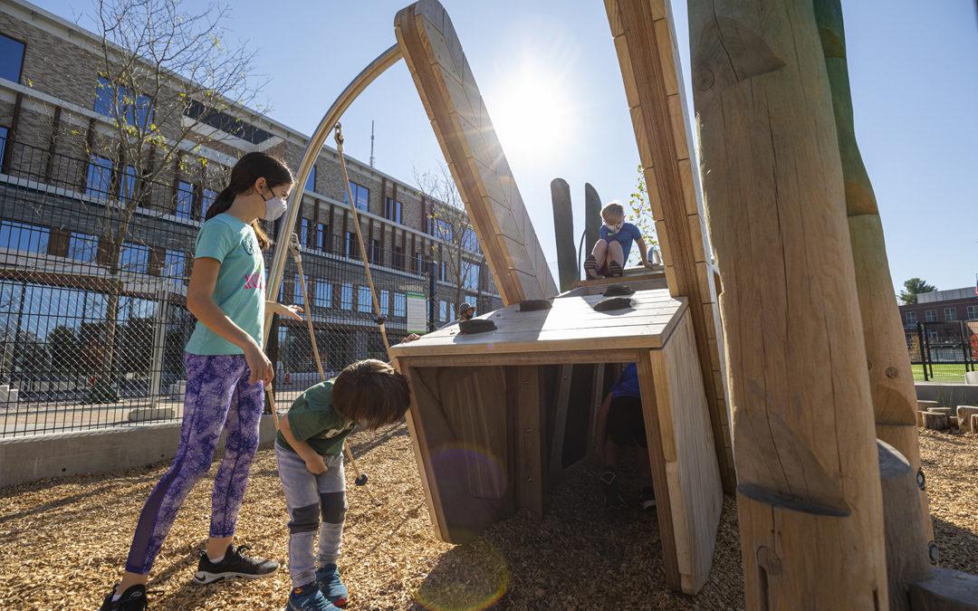 Georgetown Day School grasshopper sculpture notched logs climbing tunnel
