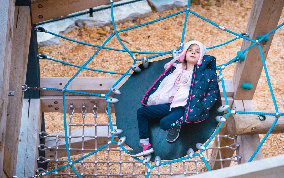 Girl lying in flex form net