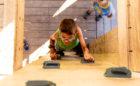 Child climbs inside of John Ball Zoo playground tower