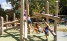 Children climb Log Jam at Grand Rapids, Michigan playground