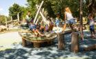Children lie on leaf deck at John Ball Zoo playground