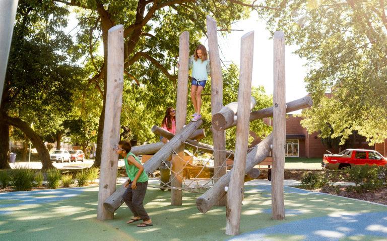 Log jam climber at John Ball Zoo with children climbing