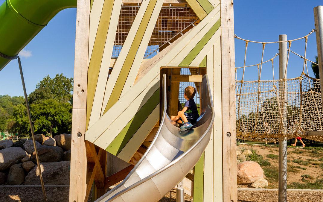 Child sliding down John Ball Zoo timber playground tower