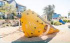 Overlook Park custom natural playground bird wood sculpture raised hut slide