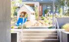 Overlook Park custom natural wood playground raised birdhouse hut slide
