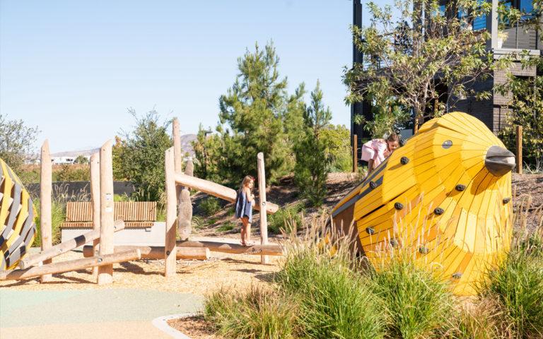 Overlook Park Irvine California bird sculpture natural playground robinia log climber