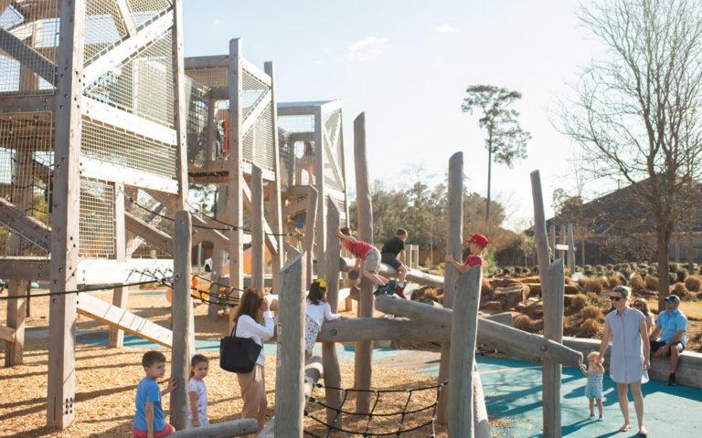 pine cove houston texas natural wood playground log climber nets timber towers