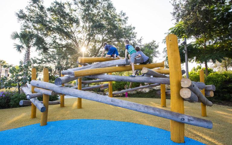 climbing to top of log nest St. Pete Pier playground