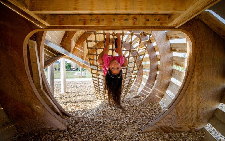 girl hangs upside down Richmond Hill playground