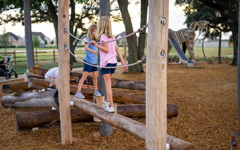 Amira natural playground Texas robinia log climbers ropes and nets