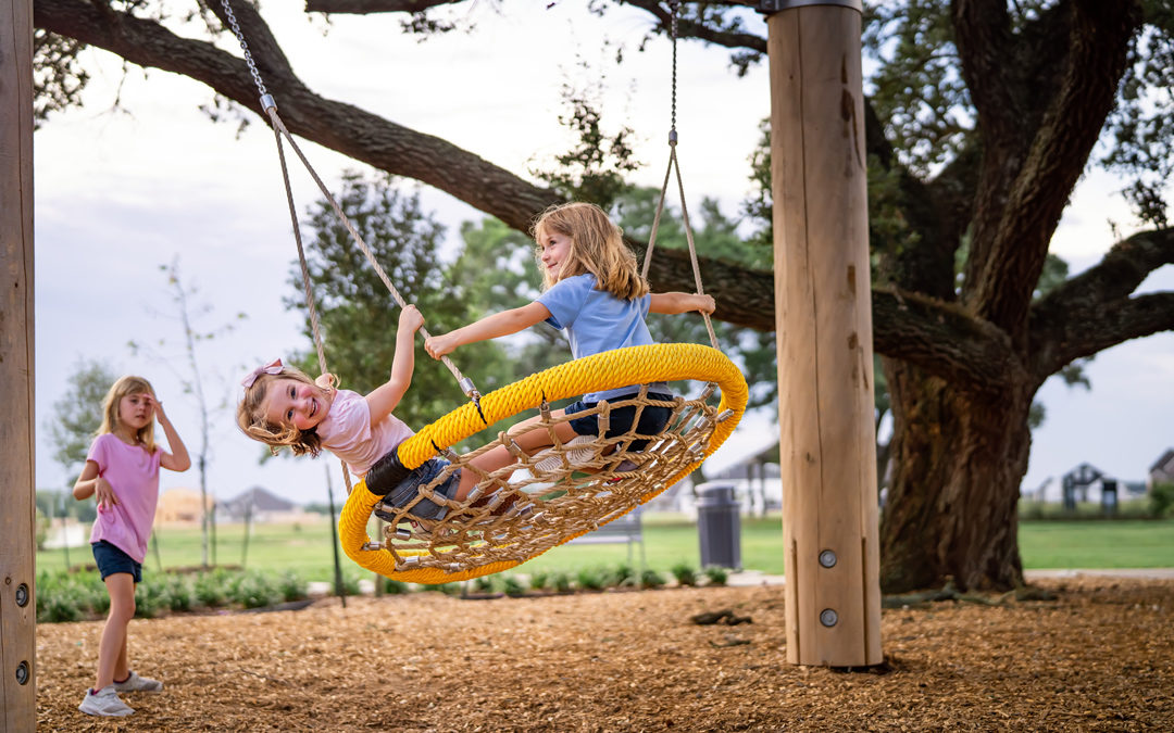 Amira Tomball Texas natural playground rope basket nest swing and log supports