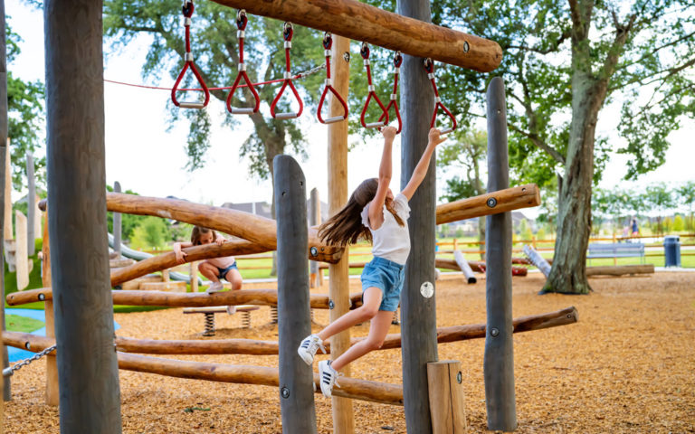 Amira Tomball Texas natural wood playground trapeze rings monkey bars robinia climber