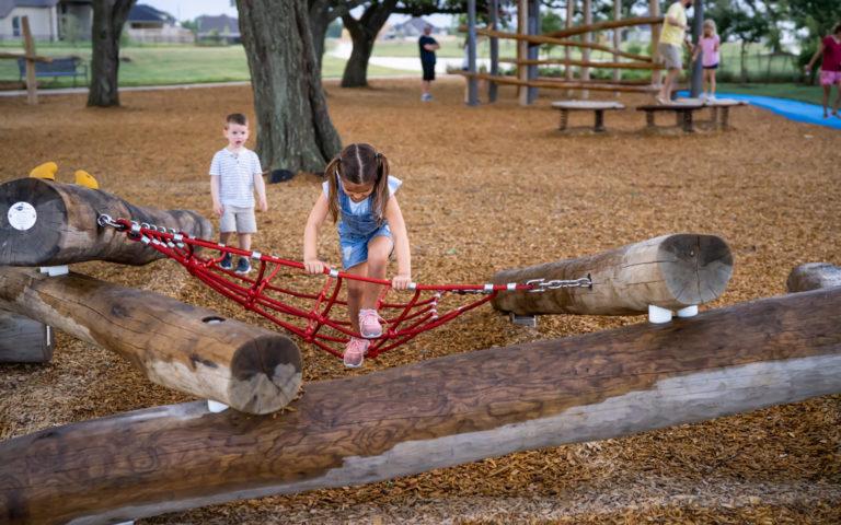natural playground tomball texas oak log pile climber rope net