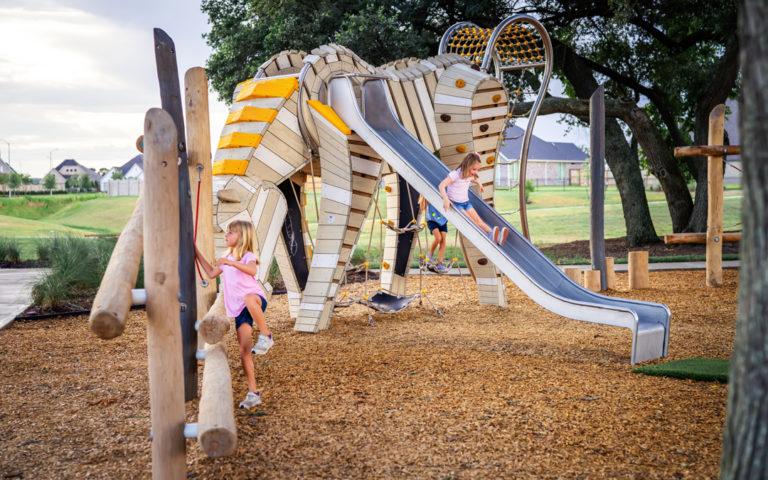 texas natural playground custom arabian grazing horse sculpture steel slide robinia logs