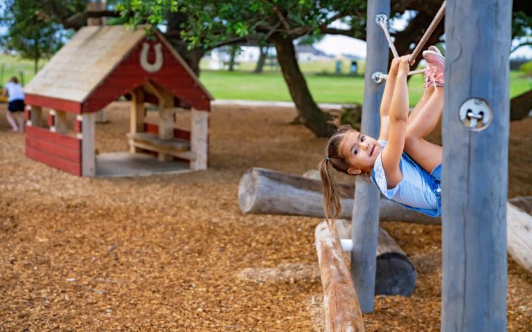 tomball texas natural playground robinia log climber ropes play hut