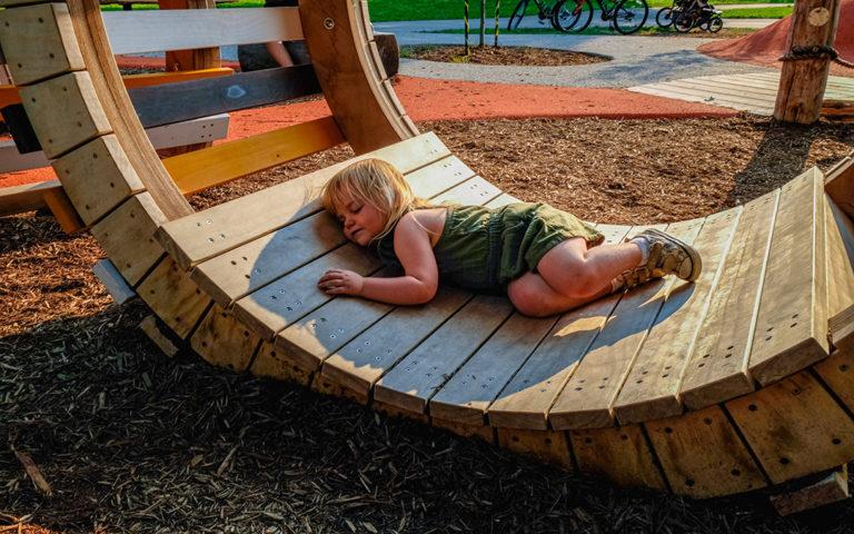 Kiwanis Park London natural playground passive play sculpture child resting