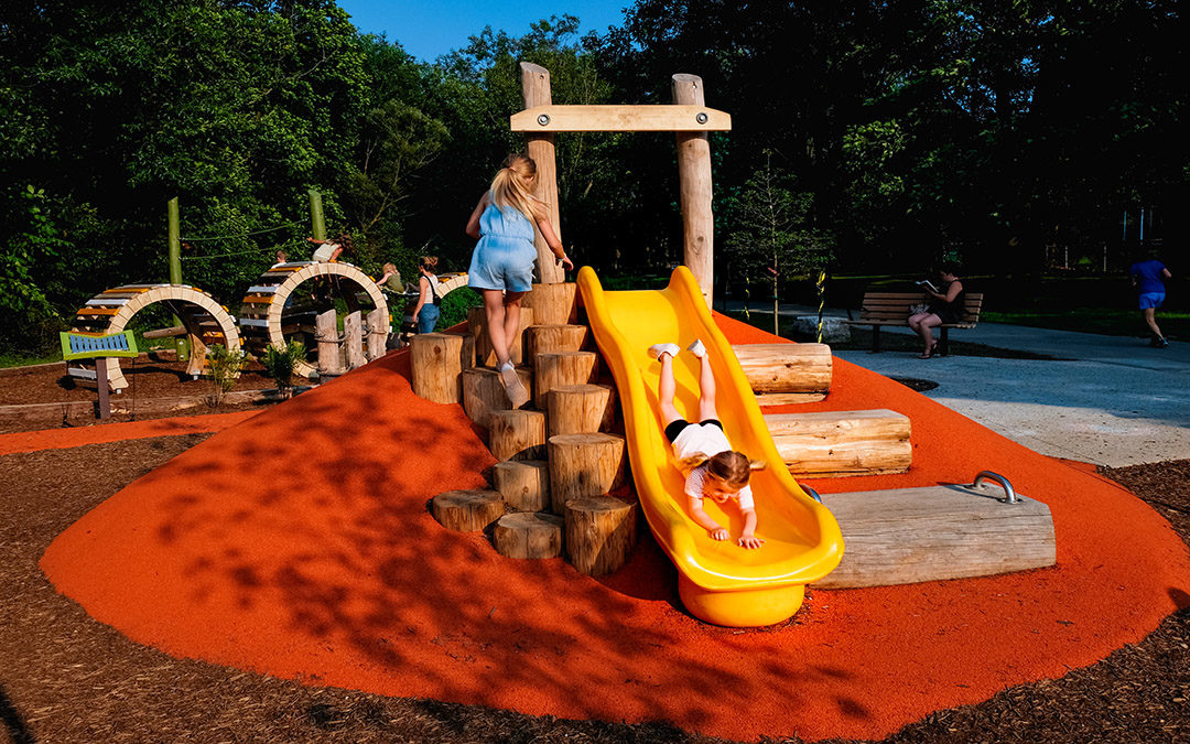 Kiwanis Park hill slide poured in place rubber surfacing natural playground