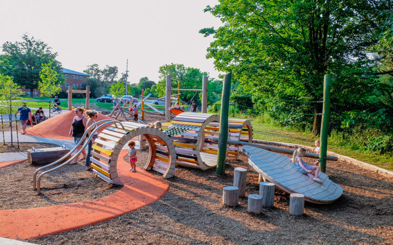 Kiwanis park monarch butterfly themed playground leaf caterpillar sculpture accessible path